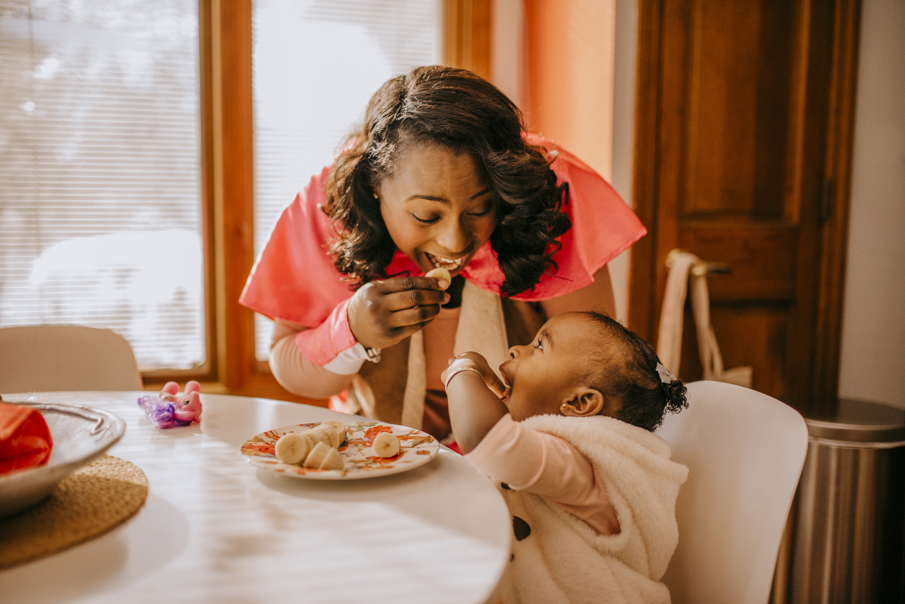 Woman and daughter eating a snack